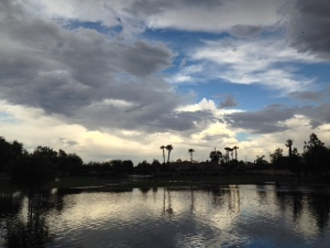 Flooded water retention basin after a desert rainstorm.