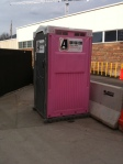 Hot pink at a construction site.